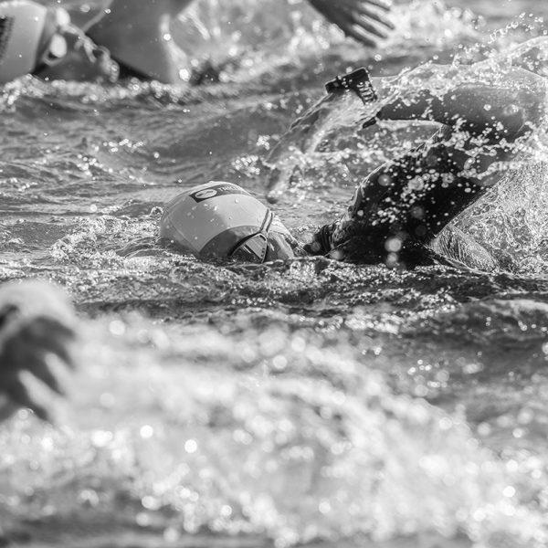 people swimming fast